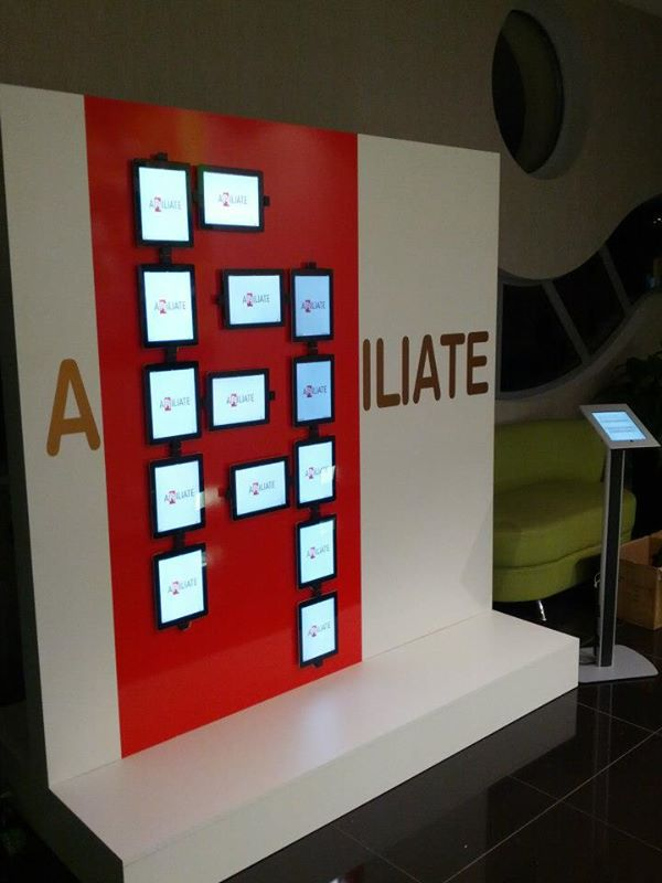 interactive iPad wall aligned to the company aspect